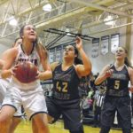 Lady Cavs hold off Titans for huge win