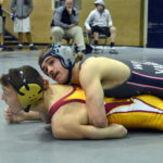 Vaught brothers claim wrestling titles for Carroll