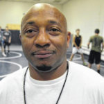 New coach has extremely high goals for Carroll wrestling