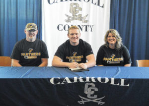 Three Carroll athletes sign to play college sports